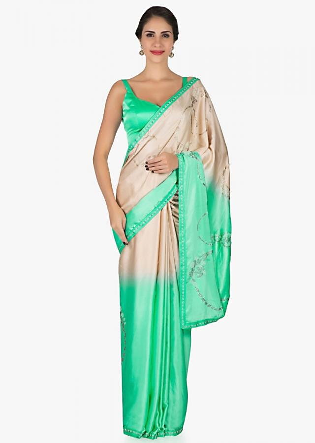 Pista green and cream saree in satin with unstitched blouse crafted in kundan embroidery work only on Kalki