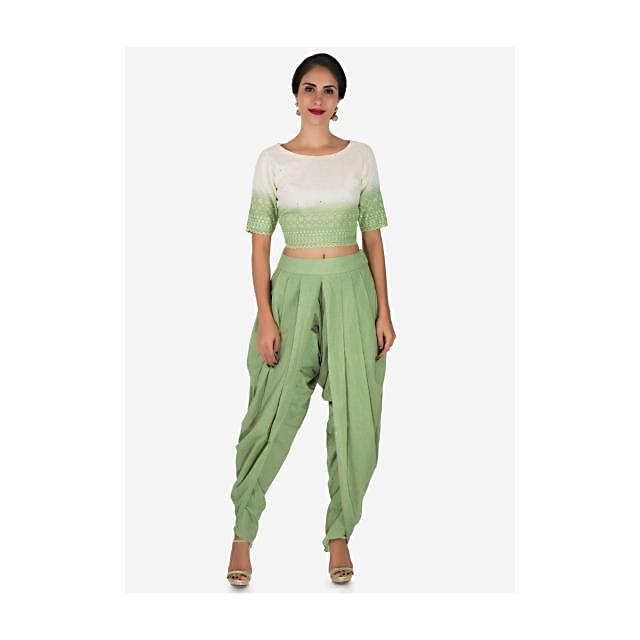 Pista green and white dhoti suit adorn in beautiful thread work only on Kalki