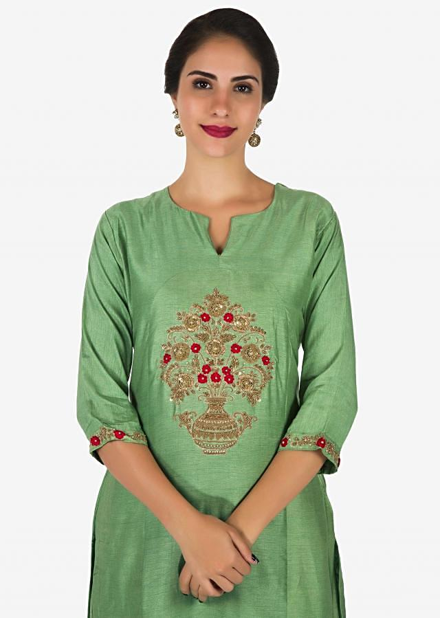 Pista green cotton palazzo suit beautified with zardosi and french knot embroidery work only on Kalki