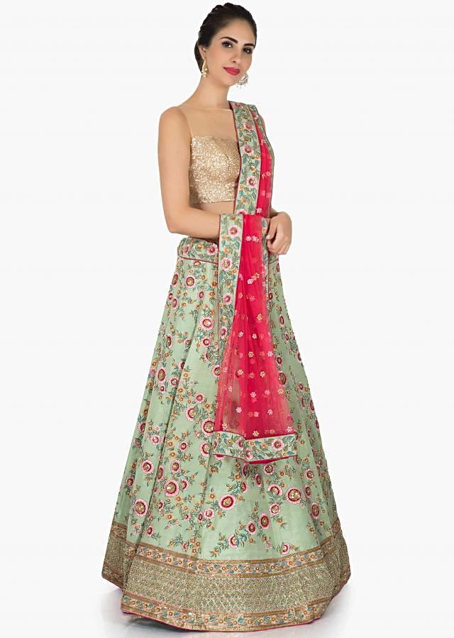 Pista Green lehenga in raw silk featuring the beautiful resham cut dana work only on Kalki