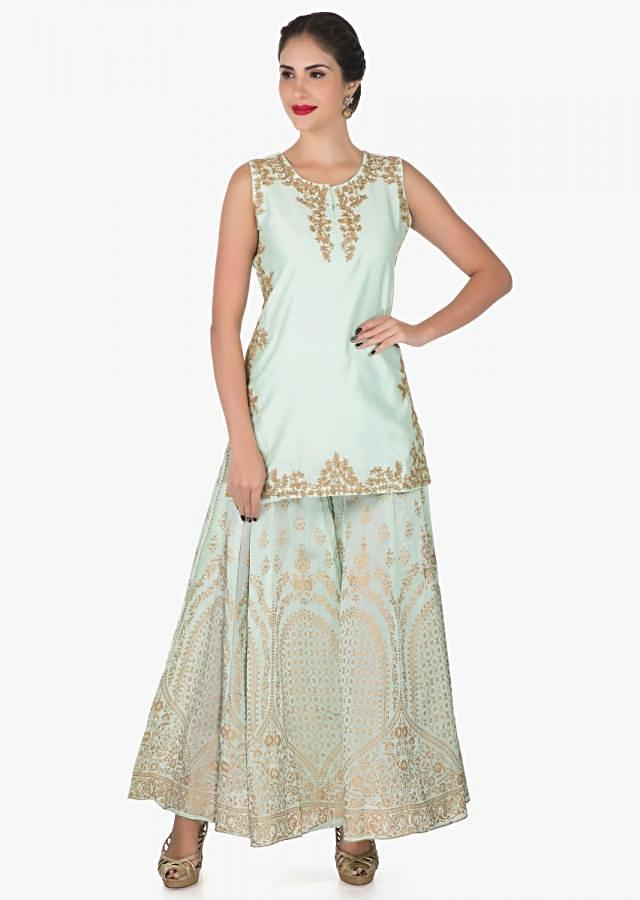 Pista green palazzo suit in silk enhanced in foil print and zari embroidered work only on Kalki