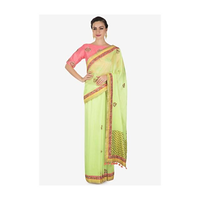 Pista green saree adorn in zardosi butti and foil printed border only on Kalki