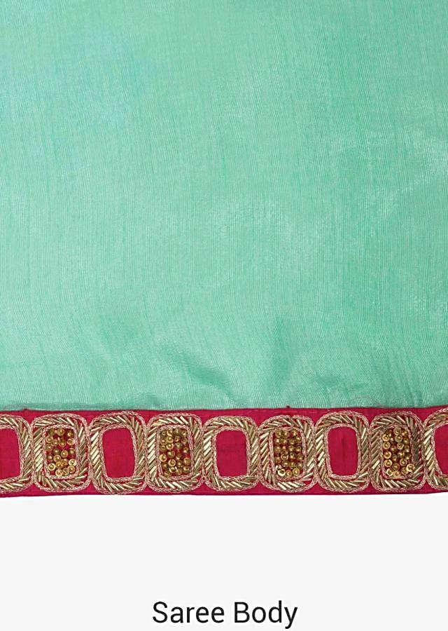 Pista green saree in cotton silk with rani pink blouse adorn in cutdana embroidery work only on Kalki