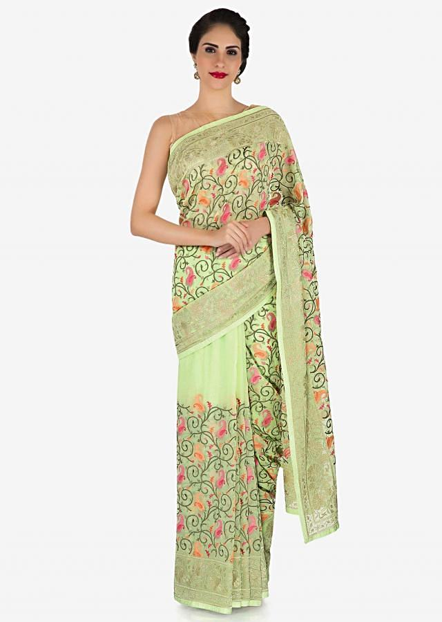 Pista green saree in georgette with paisley motif embroidery only on Kalki