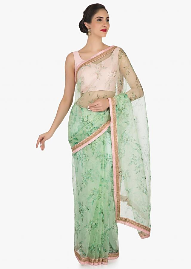 Pista green saree in tissue print with an unstitched blouse in raw silk only on Kalki