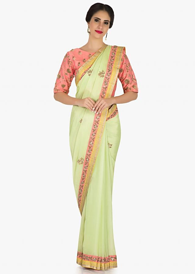 Pista green saree with ready pink blouse flaunting the foil print borders and zardosi work only on Kalki