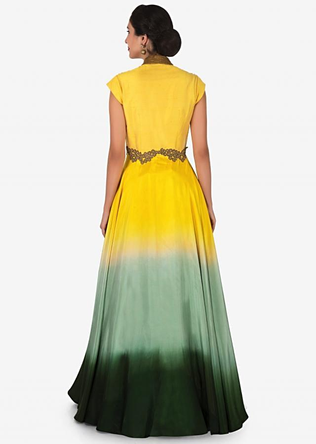 Pista green silk skirt with a yellow long jacket adorn in heavy zardosi embroidery work only on Kalki