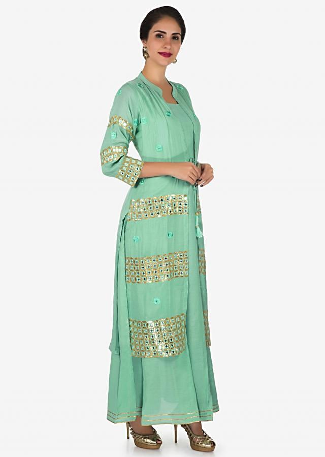 Pista green tunic in cotton adorn in gotapatti and resham embroidery work only on Kalki