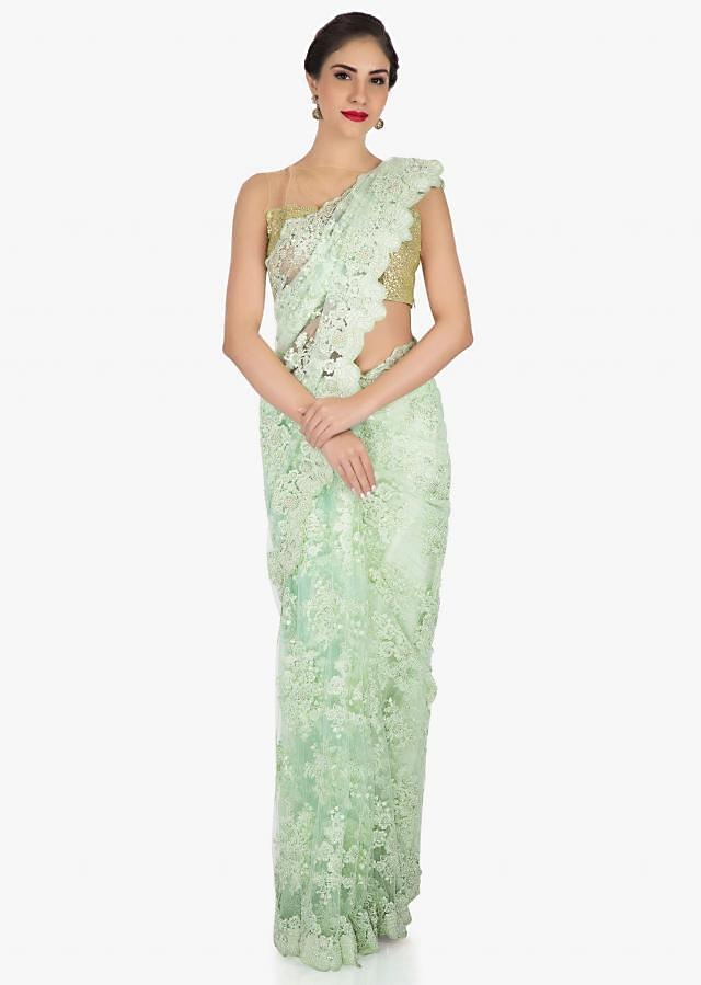 Pista green saree in embroidered net crafted in resham and moti embroidered work only on Kalki