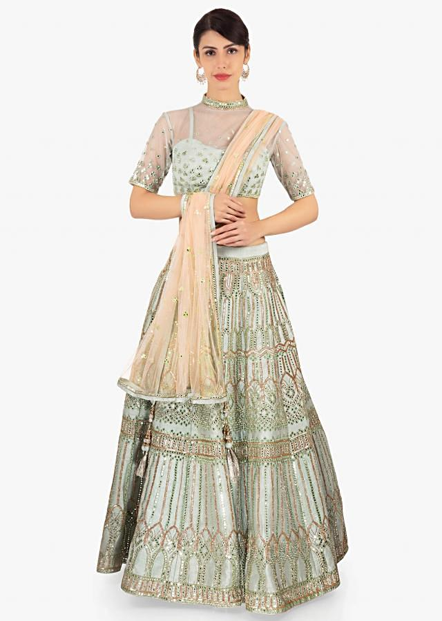 Helly Shah pistachio green embellished net lehenga paired with a matching net blouse and light cream net dupatta