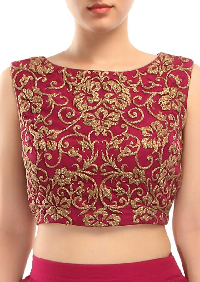 Plum outfit adorn in embossed zari embroidery only on Kalki