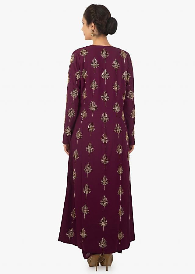 Plum purple crop top and dhoti salwar paired with a long jacket adorn only on Kalki