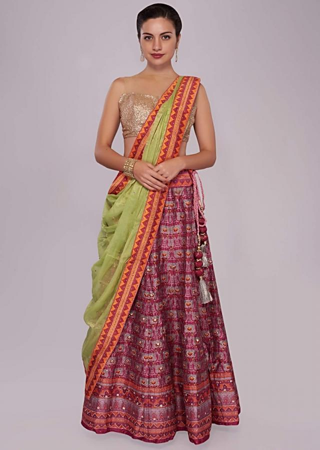 Plum silk lehenga in patola print with contrast border only on Kalki