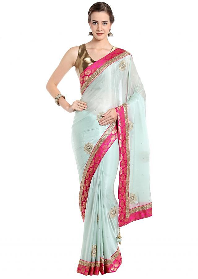 Pool blue saree in satin chiffon with embroidered butti only on Kalki