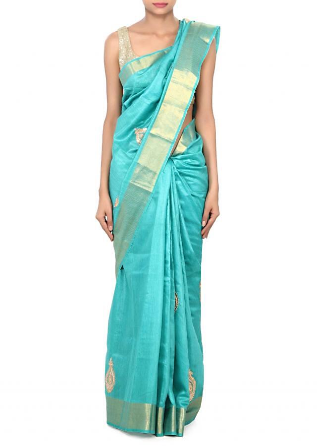 Pool green silk saree adorn in gotta patch butti only on Kalki