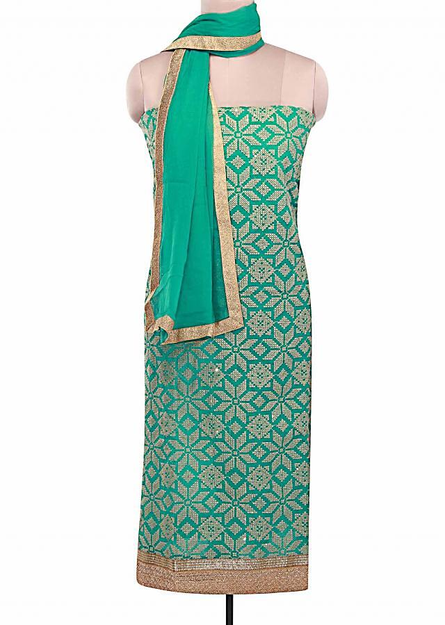 Pool green unstitched suit adorn in geometric motif embroidery in resham only on Kalki