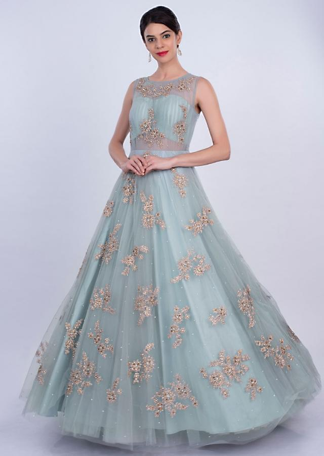 Powder blue double layer net gown with zari embroidered butti only on Kalki
