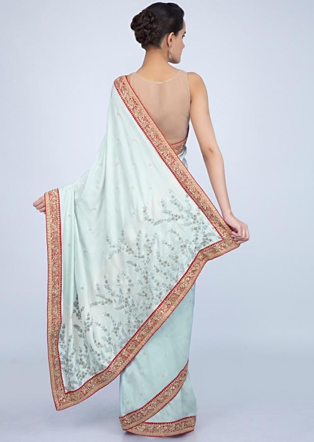 Powder blue dupion silk saree with contrasting embroidered border only on Kalki