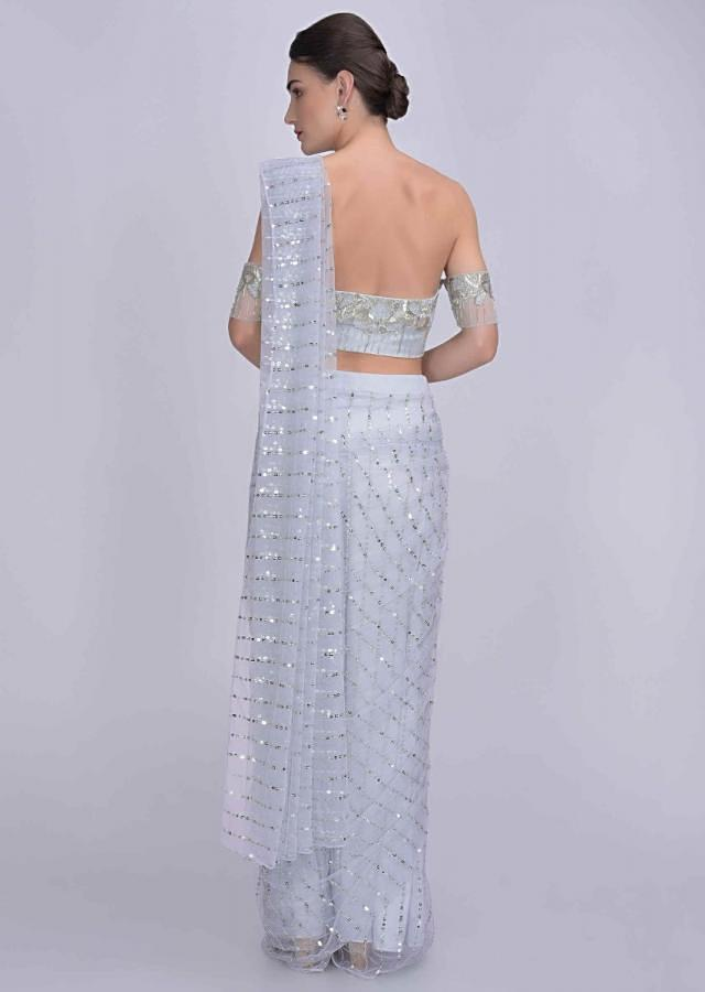 Powder Blue Crop Top And Ready Pleated Saree In Net With Cut Dana Work Online - Kalki Fashion