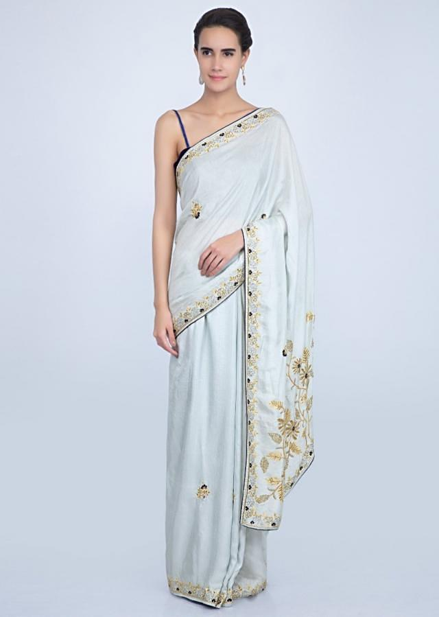 Powder blue silk saree with cut dana and resham embroidery only on Kalki