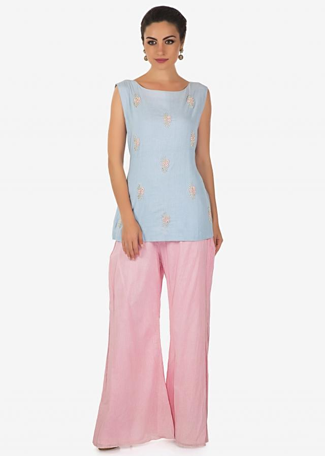 Powder blue top in moti butti matched with palazzo pant and pink floral printed jacket only on Kalki