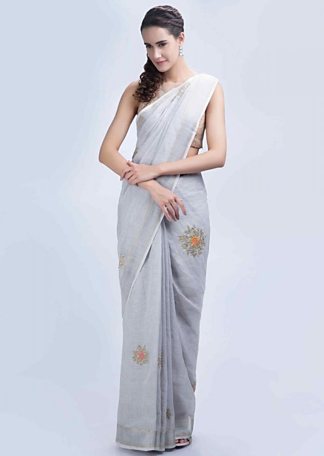 Powder grey linen saree with floral embroidered butti only on Kalki