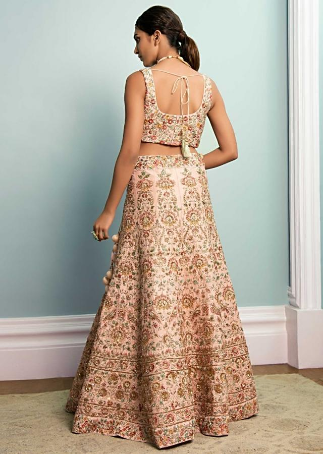 Powder Peach Lehenga Choli In Raw Silk With Hand Embroidered Flower And Bird Pattern Online - Kalki Fashion