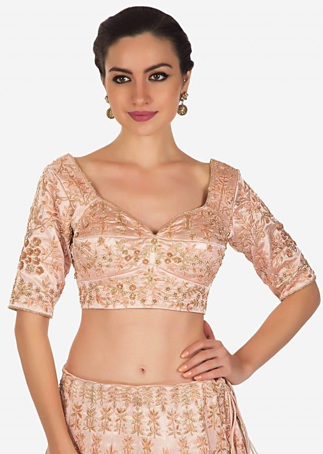 Powder peach lehenga in embellished in resham and cut dana embroidery all over only on Kalki