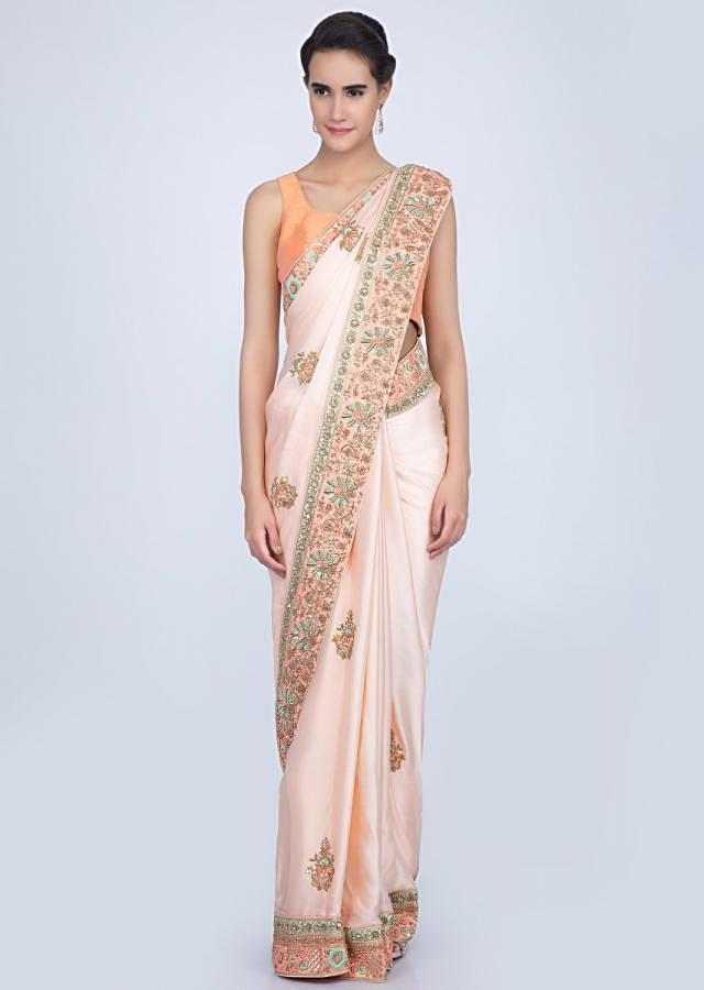 Powder Peach Saree In Satin With Butti And Heavy Embroidered Border Online - Kalki Fashion