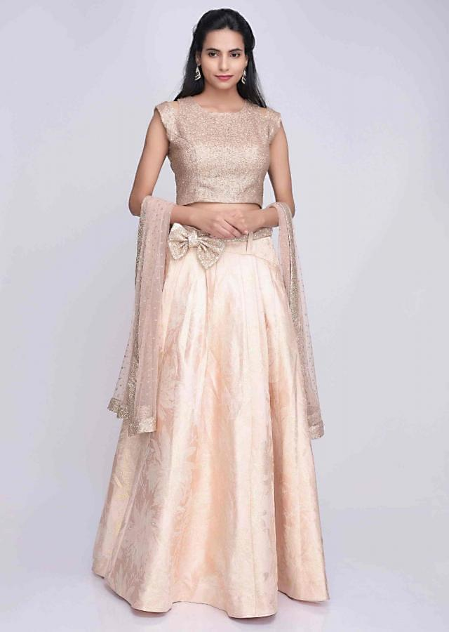 Powder peach weaved floral satin lehenga set with gold net dupatta with sequins bow belt only on Kalki