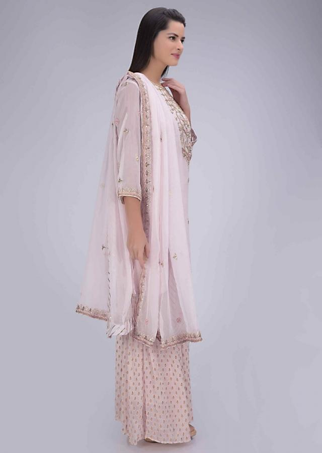 Powder pink chiffon suit with sharara bottoms only on Kalki