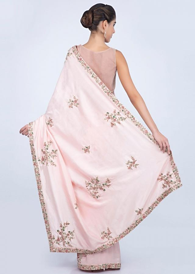Powder pink dupion silk saree with florrla embroidered butti and border only on kalki