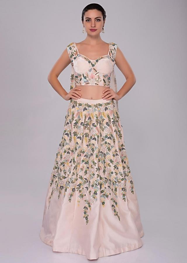 Powder pink hand and machine embroidered lehenga and corset with shoulder cape only on Kalki