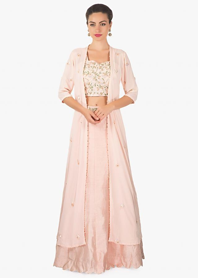 Powder pink lehenga matched with crop top blouse and long embroidered jacket only on Kalki