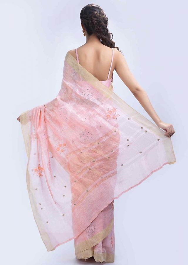 Powder pink linen saree with floral embroidered butti only on Kalki