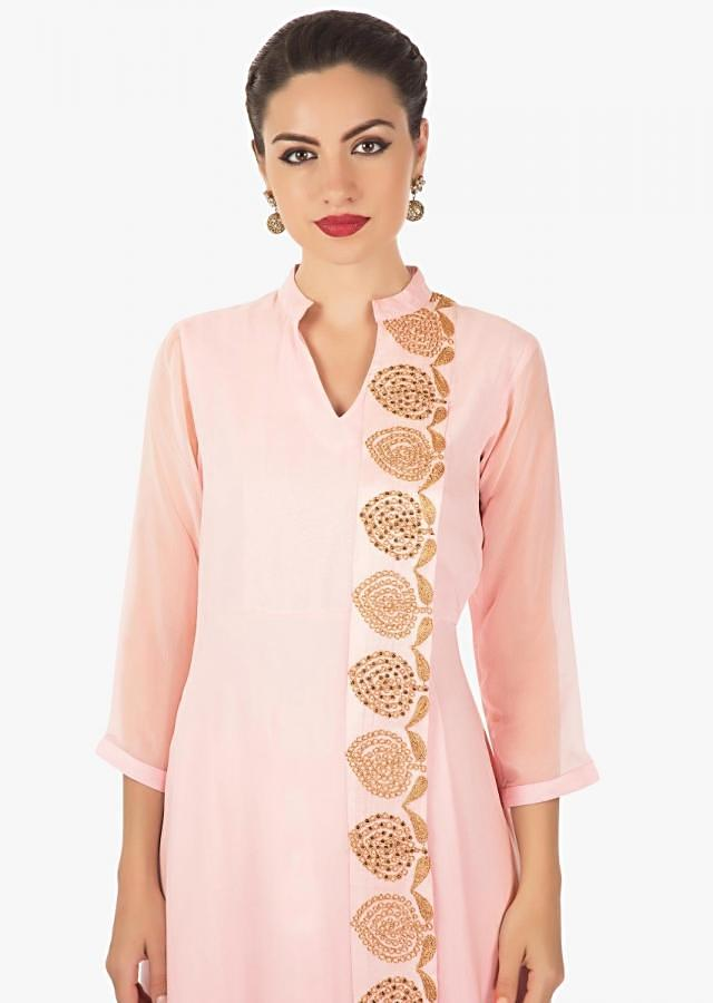 Powder pink ling dress with top layer highlighted in moti and zari work only on Kalki