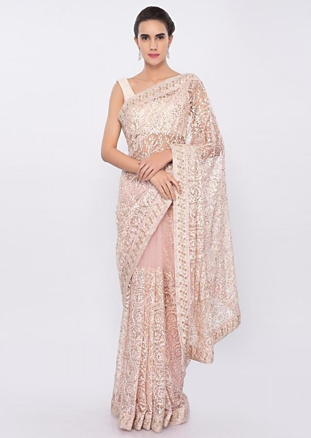 Powder pink net saree in resham jaal embroidery with sequins highlight only on Kalki