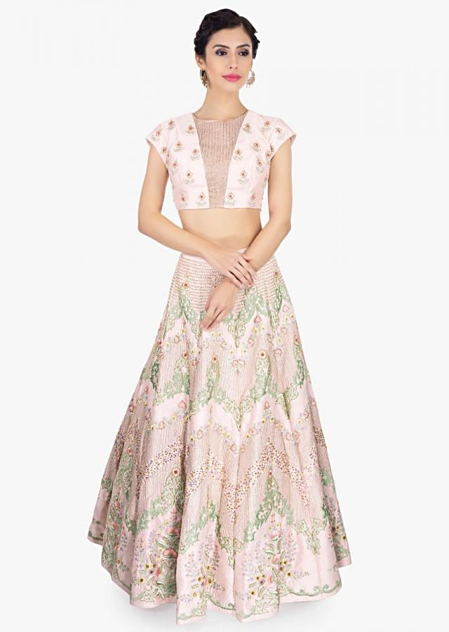 Powder pink raw silk embroidered lehenga set paired with pistachio green net dupatta only on Kalki