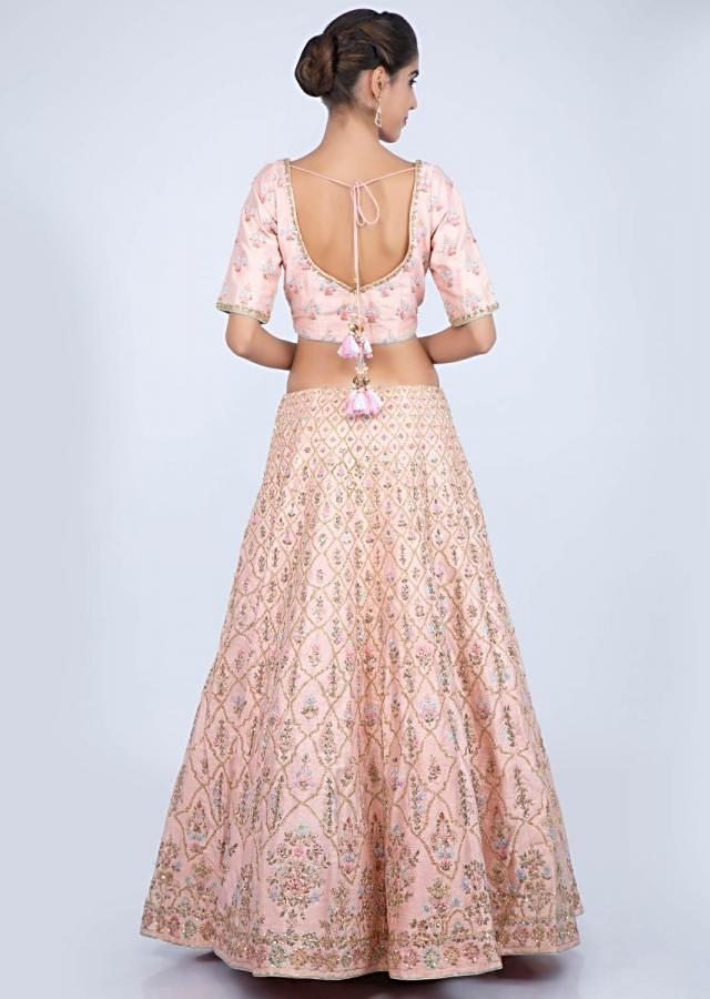 Powder pink raw silk lehenga with heavy floral jaal embroidery only on kalki