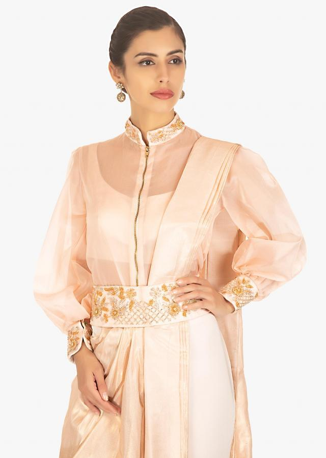 Powder pink saree with pants paired with matching crop top and fancy jacket only on Kalki