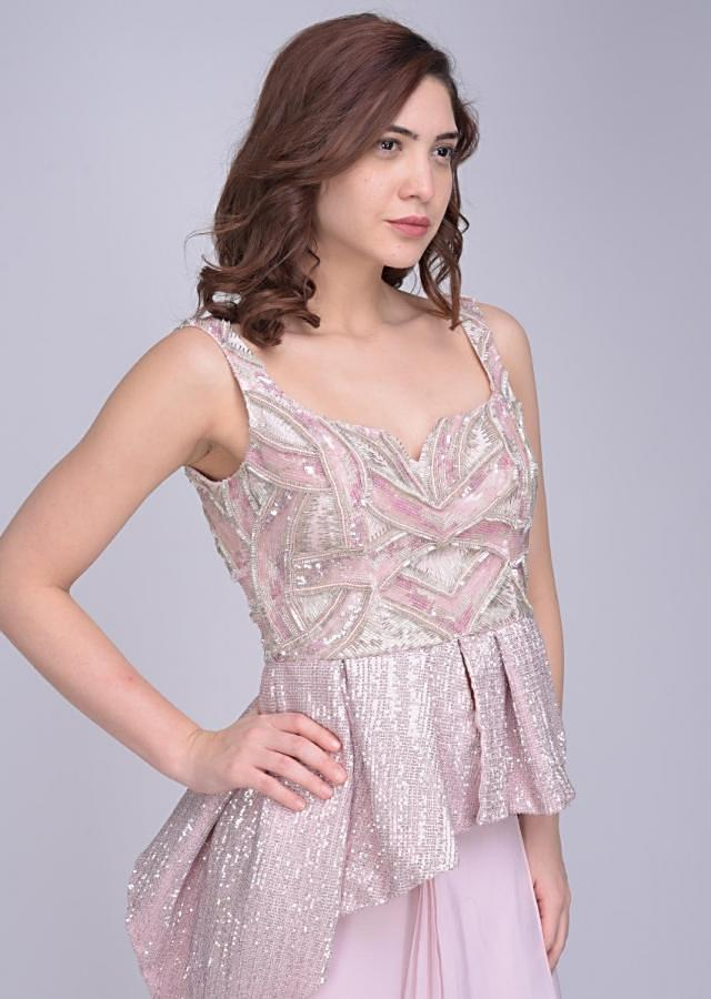Powder pink skirt with cascading layers matched with a fancy peplum top only on Kalki