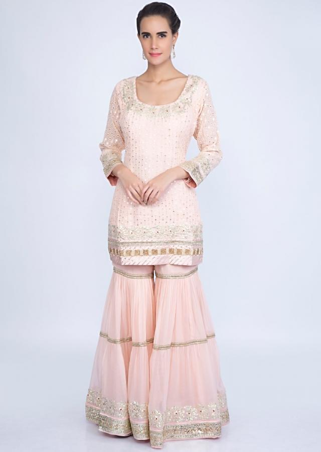 Powder pink thread embroidered sharara suit set with net dupatta only on kalki