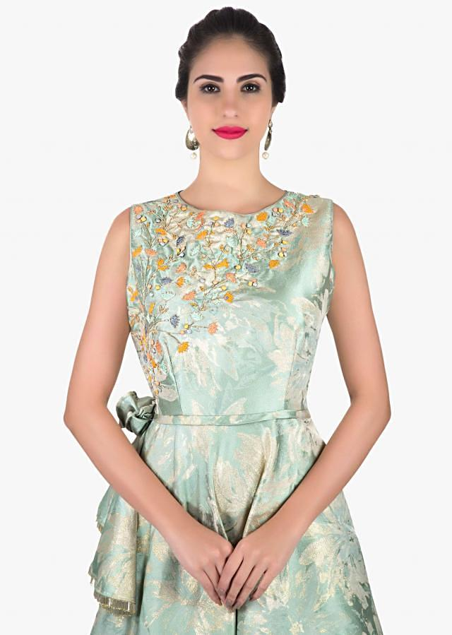 Powder blue gown in french knot embroidery with fancy flower only on Kalki