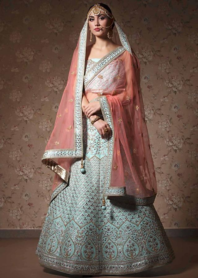 Powder blue lehenga with unstitched blouse in gotta patch and zari embroidery