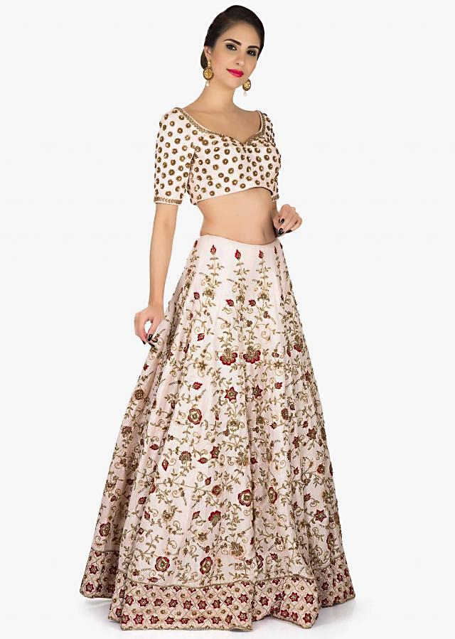 Powder pink lehenga in silk with a ready blouse embroidered in Kundan and Zardosi only on Kalki