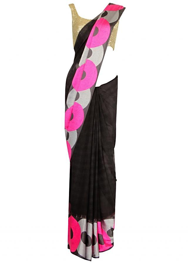 Onyx black saree adorn in colourful polka dots print only on Kalki