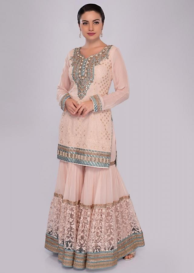 Kanchi Singh in cream self thread embroidered sharara suit set with mint green net dupatta