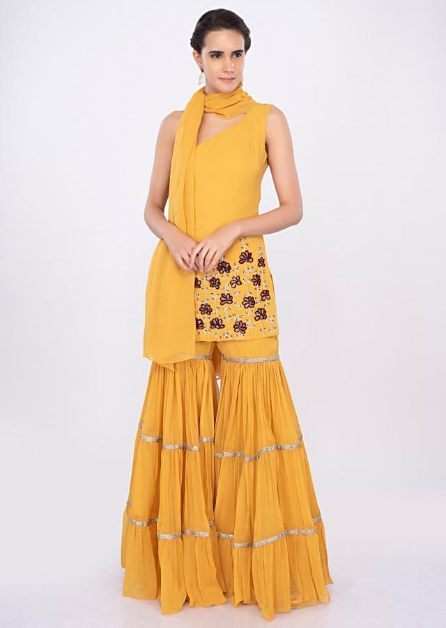 Prakriti Kakar in kalki one shoulder mustard sharara set with wrap around stitch dupatta