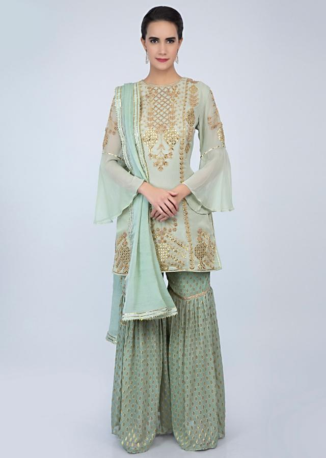 Pista green georgette sharara suit set with front panel embroidery and side butti only on Kalki