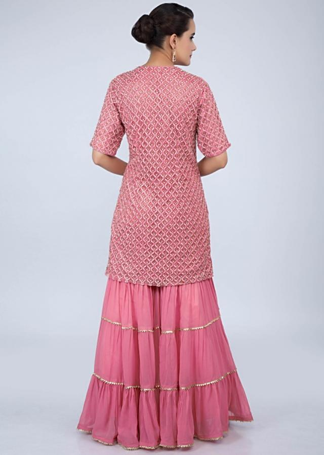 Punch pink heavy embroidered sharara suit set with cut dana and sequins work only on Kalki
